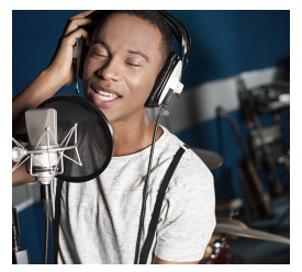 Male singer recording a song