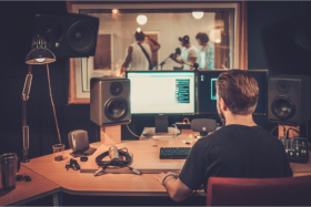 Band recording song in a studio