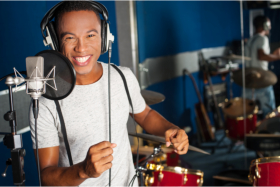 Happy guy in a recording studio