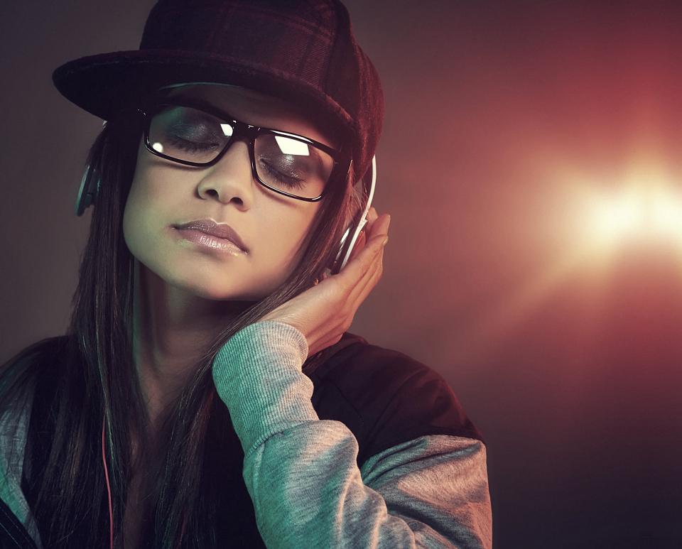 Female singer listening to a song using a headphone
